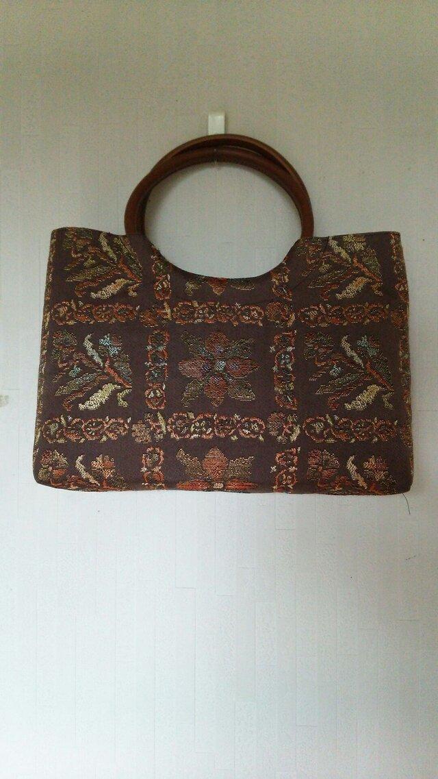 帯と皮の丸い手でバッグの画像1枚目