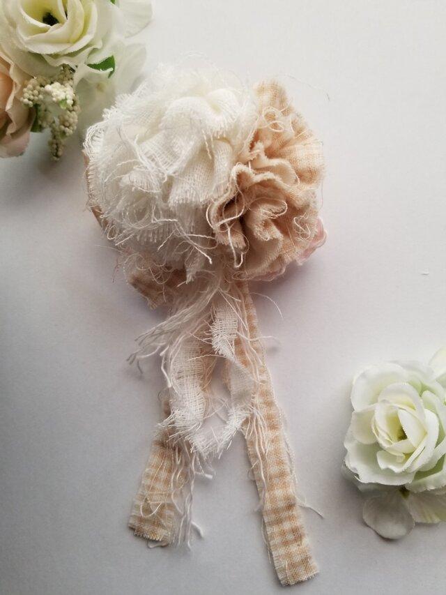 オーガニックコットンのお花のコサージュの画像1枚目
