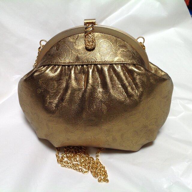 アンティークゴールドのバッグの画像1枚目