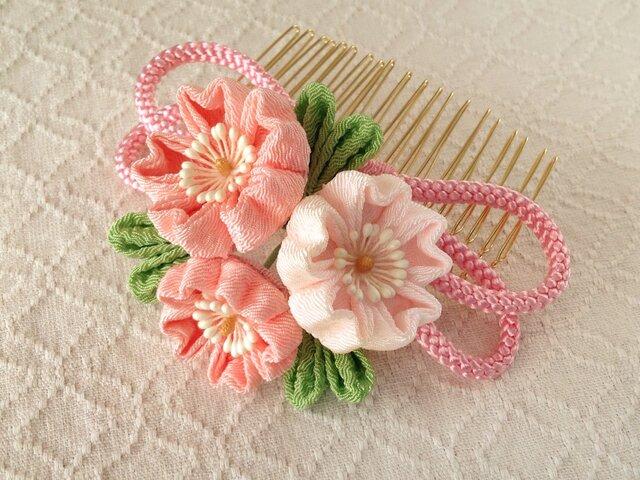 〈つまみ細工〉桜と江戸打ち紐のコーム(サーモンピンクと淡桜)の画像1枚目
