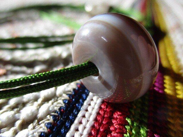 再販 緩やかな曲線の和太鼓型 天眼石 お紐仕立て 無段階調節可能ネックレスの画像1枚目