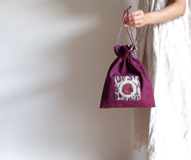 リネンの巾着袋 - 赤紫に豹と花 -の画像1枚目
