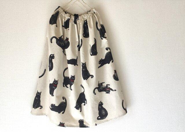 こなまいきな黒猫*ロングスカート*コットンリネン*生成りの画像1枚目