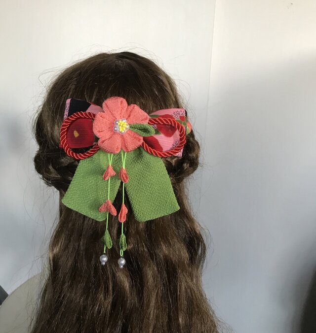 オレンジと黄緑の椿リボンの髪飾りセット(卒業式・袴・ちりめん細工)の画像1枚目
