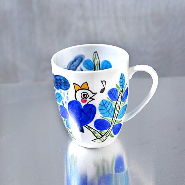 梢で語らう青いハート鳥のマグカップ・ボーンチャイナの画像1枚目
