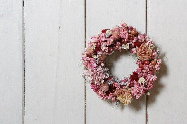 ピンクの小花のミニリースの画像1枚目