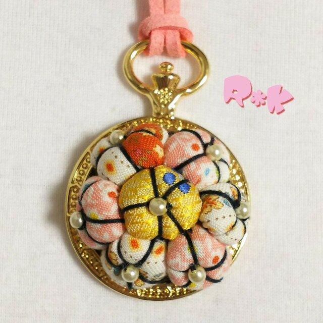 懐中時計のレトロな花のネックレスの画像1枚目