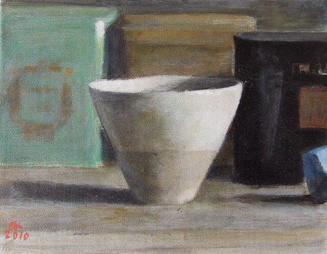カップと3つの紅茶の缶の画像1枚目