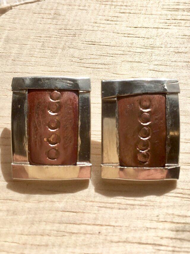 銀と銅のイヤリングの画像1枚目