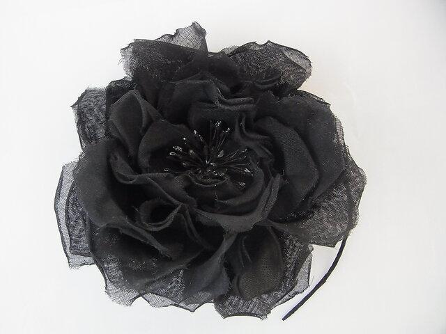 黒いバラの一輪コサージュの画像1枚目