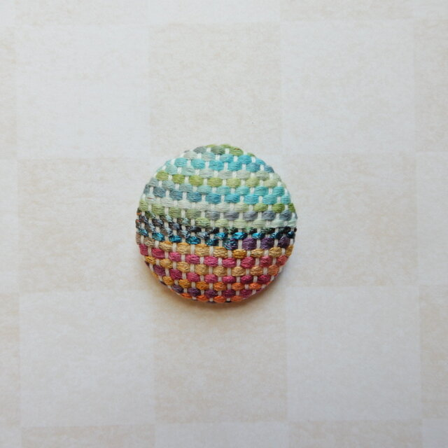 春めく手織りのブローチの画像1枚目