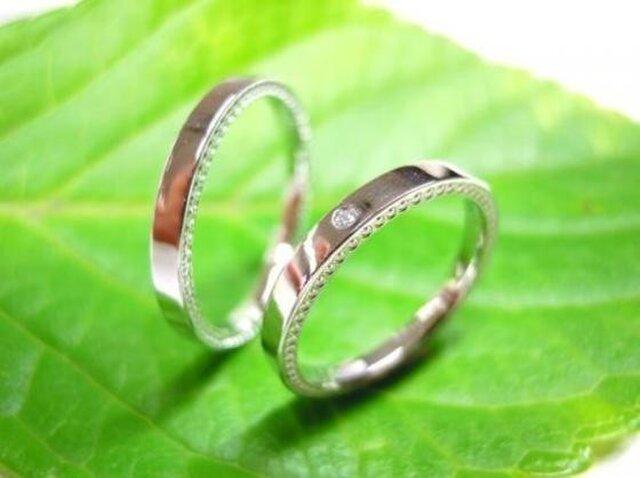 手作りプラチナ結婚指輪・両サイドミル打ち・女性用ダイヤ入りの画像1枚目