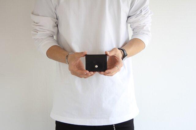 手元にすっぽり収まるかわいいコインケースの画像1枚目