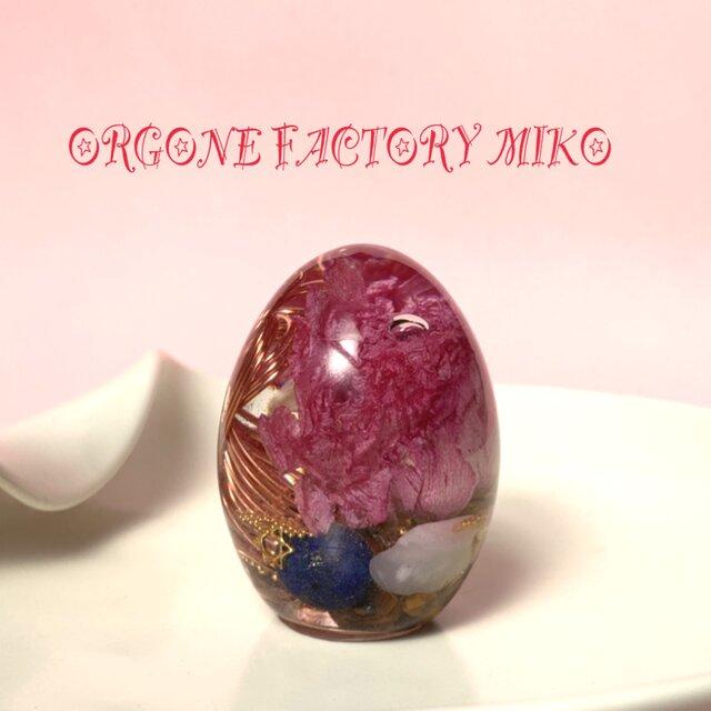 金運・幸運・仕事運のツルツル卵 幸運メモリーオイル入 聖なる石のケオン入り オルゴナイトの画像1枚目