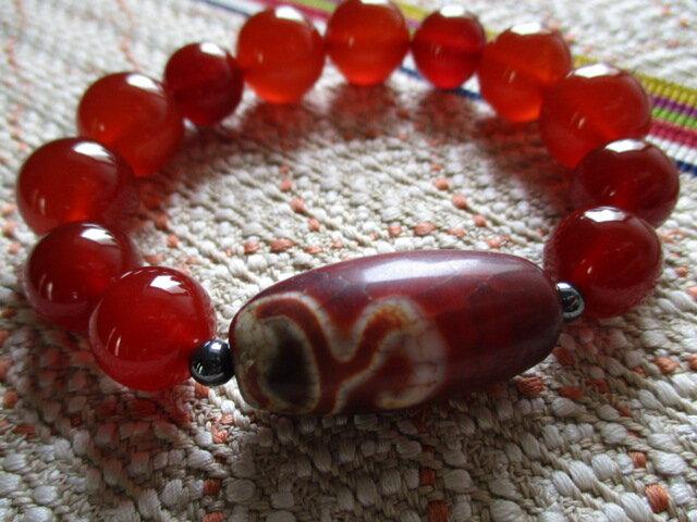 ぼ様ご予約 レッドカーネリアン/紅玉髄と赤龍紋 一眼水蓮花天珠 のブレスレットの画像1枚目