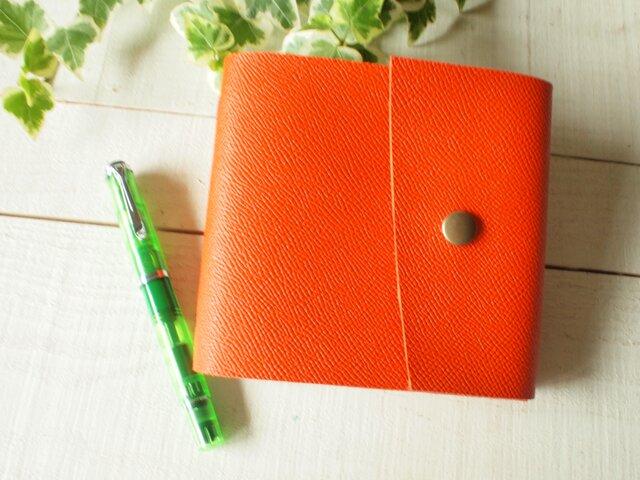 ◆本革 手のひらメモ帳 夕張メロンなオレンジ色 自然な切り口の画像1枚目