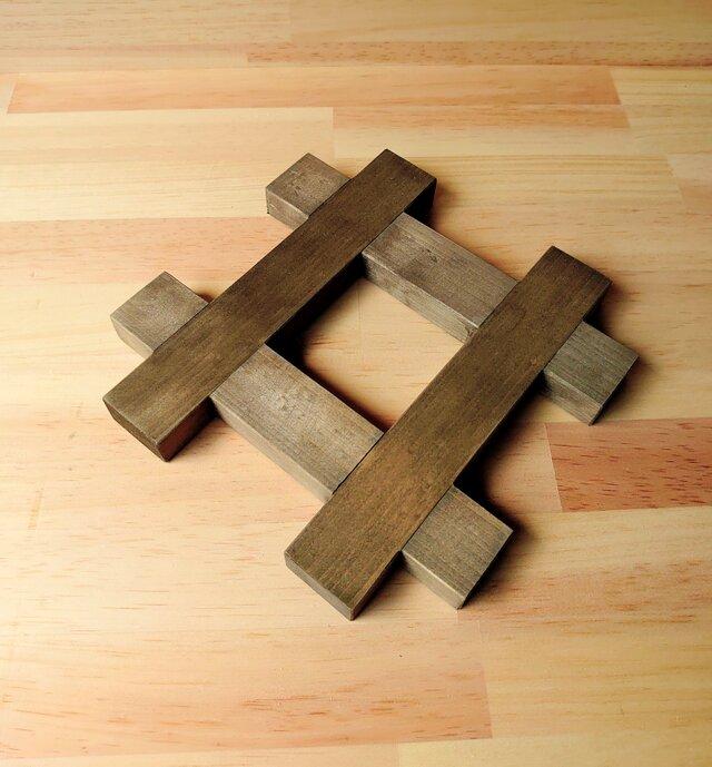 モダンなナベ敷き、シャープ型、天然木の画像1枚目