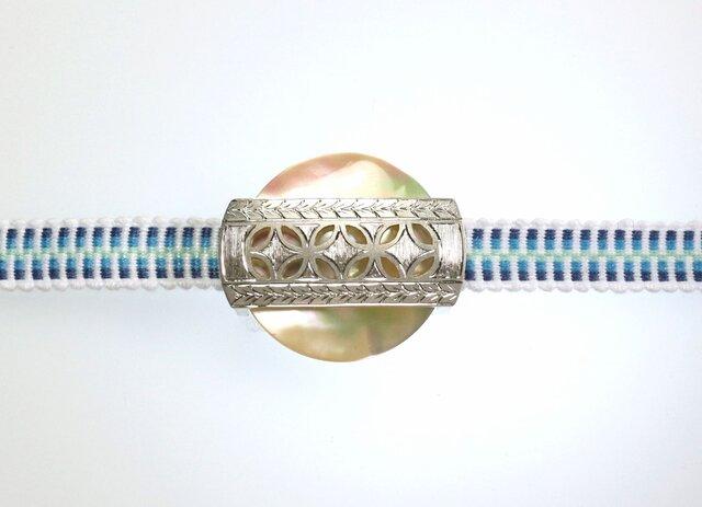 帯留め 夜光貝と銀細工の画像1枚目