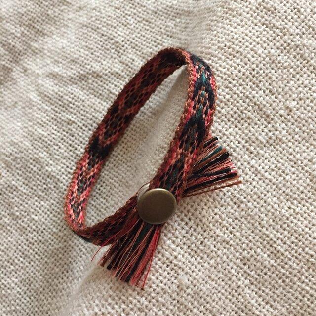 手織りのブレスレット オレンジ×黒 (A)の画像1枚目