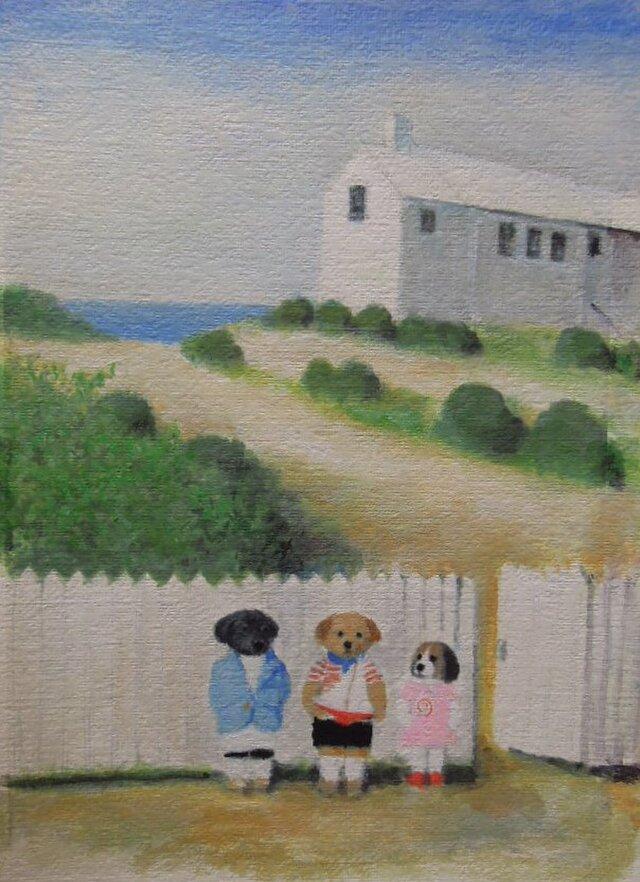 海のそばの白い家とヨットの画像1枚目