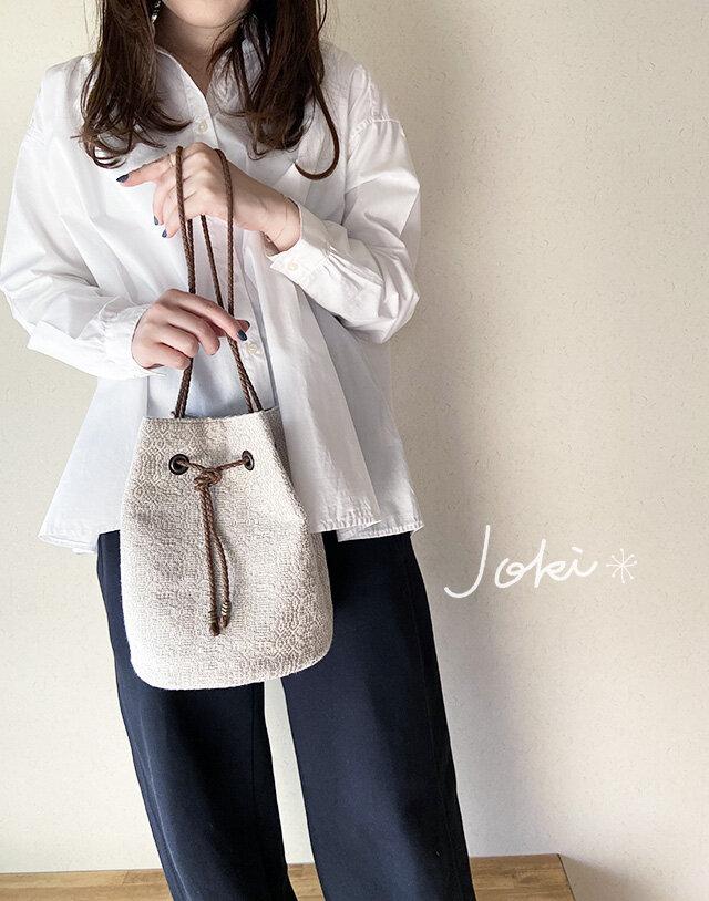 bag[手織りオーバーショット織  巾着バッグ]クリームホワイトの画像1枚目