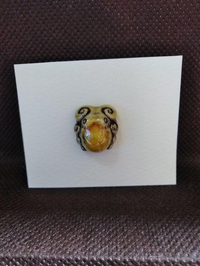 動物石 ピンズ タコ(黄色)の画像1枚目