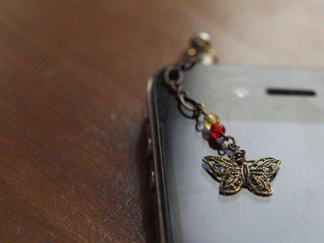 レトロな蝶のスマホピアスの画像1枚目