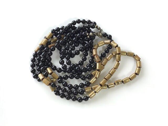 黒と金色のネックレス / 珊瑚, オニキス, 天然石の画像1枚目