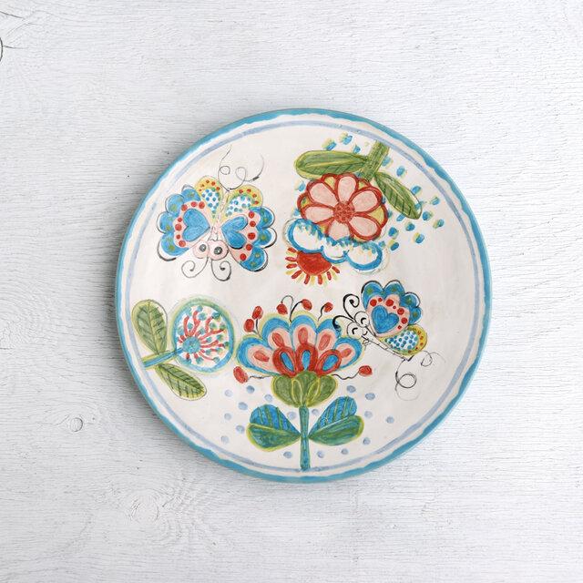 花と蝶絵の平皿(水色)の画像1枚目