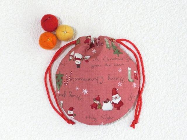 ミニ巾着袋 サンタさんと仲間 ピンク色 御守り アクセ プレゼントにも の画像1枚目