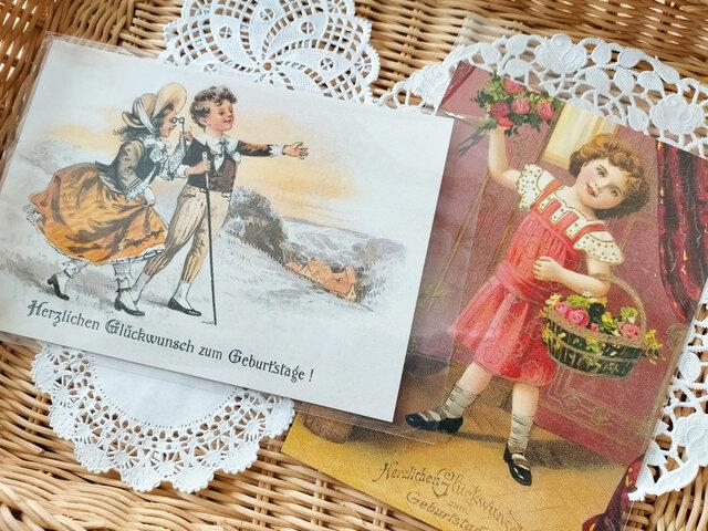 ドイツ製ポストカード【Germay】2枚セット(花かごをもった少女/夜明けの丘)の画像1枚目