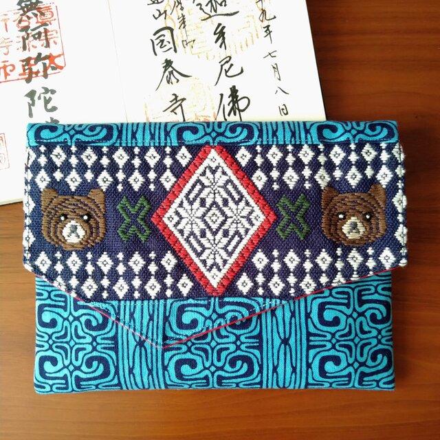 雪の結晶とキムンカムイの御朱印帳袋(青系×紺2021年夏ver.)の画像1枚目