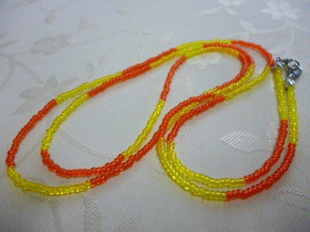 丸小ビーズロングネックレス(黄×赤)の画像1枚目