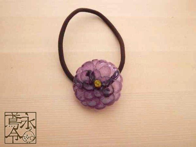 髪ゴム 薄い紫色の大きめの丸い花の画像1枚目