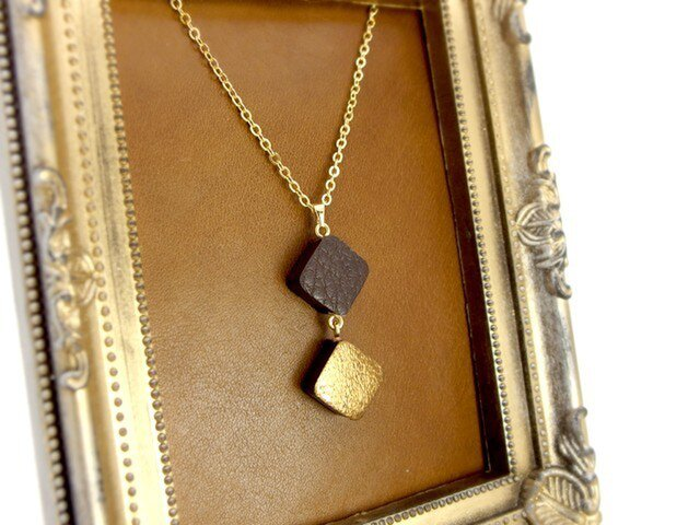 ゴールド&ブラウンレザーのネックレスの画像1枚目