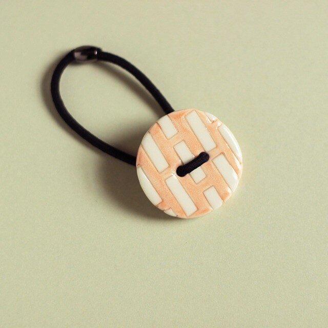 磁器ボタンゴム 丸ミシン ピンクの画像1枚目