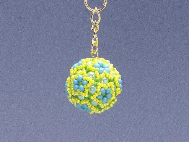 星型の花模様のボールの携帯ストラップ・イエローの画像1枚目
