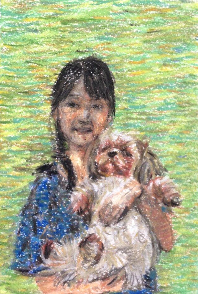 少女と犬の画像1枚目