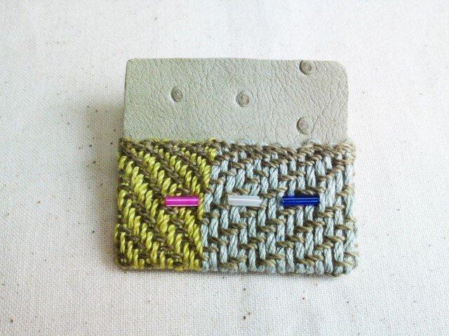 「夜になると5」手織り布・革 ブローチの画像1枚目