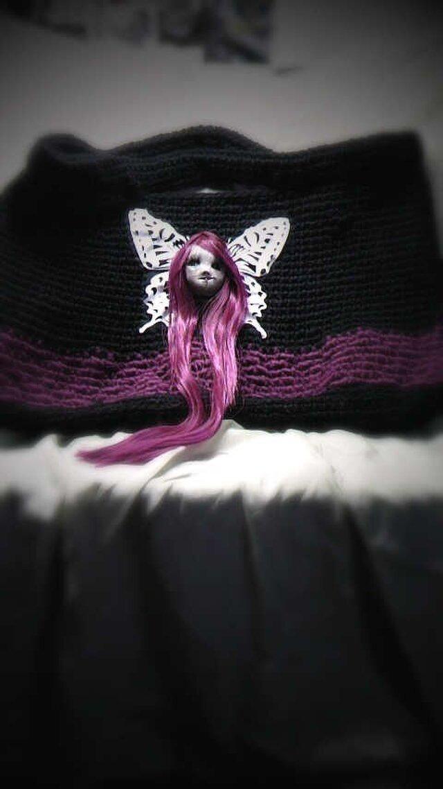蝶と赤毛の生首バッグの画像1枚目