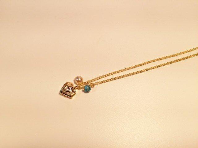 輝くダイヤモンドにトルコ石とパールのネックレスの画像1枚目