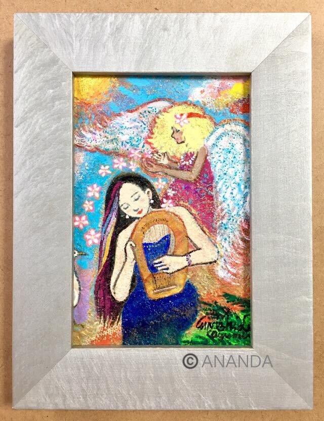【ハワイの天使とライアーを弾く女性】の画像1枚目