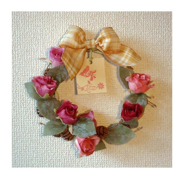 薔薇のリース飾りの画像1枚目