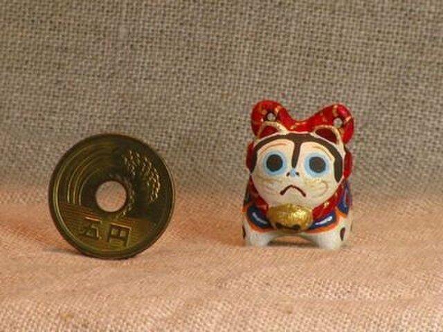 小さな小さな犬張り子(木彫り)の画像1枚目