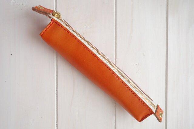 ★クールオレンジのかわいらしい三角型本革ペンケースの画像1枚目