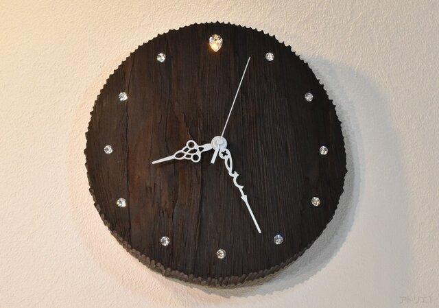 【まい様専用】荒々しいアフリカの大地の漆黒の夜の星空を思わせる木の掛け時計の画像1枚目