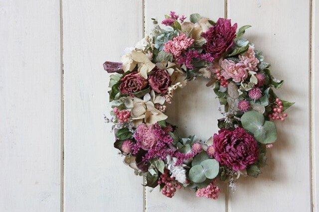 ピンクのお花のリースの画像1枚目