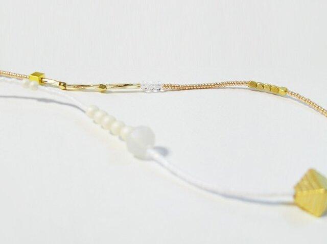 白×ゴールドの2toneネックレスの画像1枚目