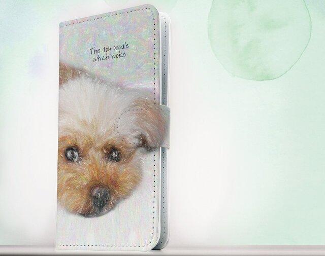 全機種対応 手帳型 スマホケース iPhoneXs iPhone9 iPhoneXs Max犬 起きた瞬間のトイプードルの画像1枚目
