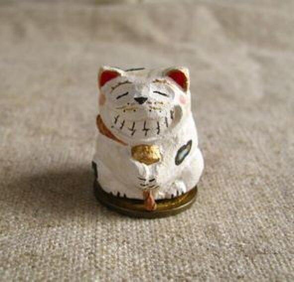 欲張り招き猫 めでたい 木彫りの画像1枚目